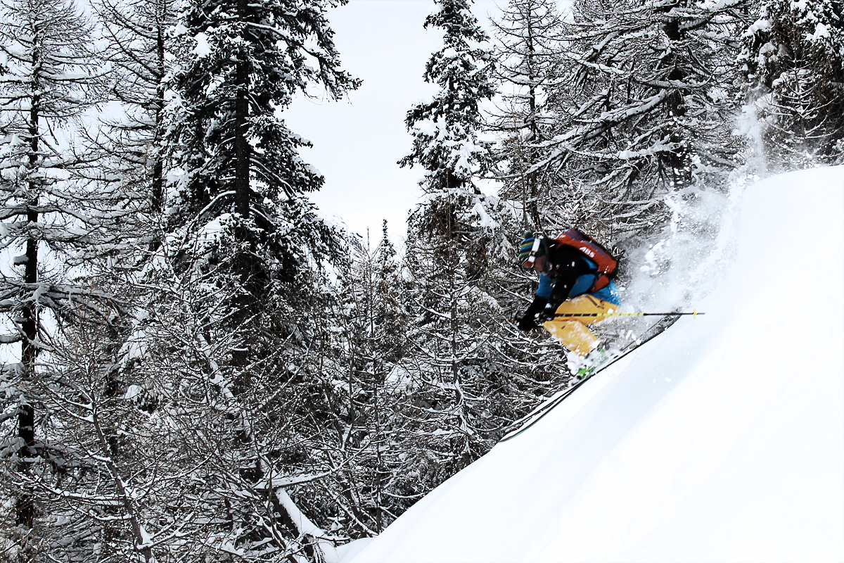Andy Houseman skiing the trees in boot deep powder at Courmayeur, Italy