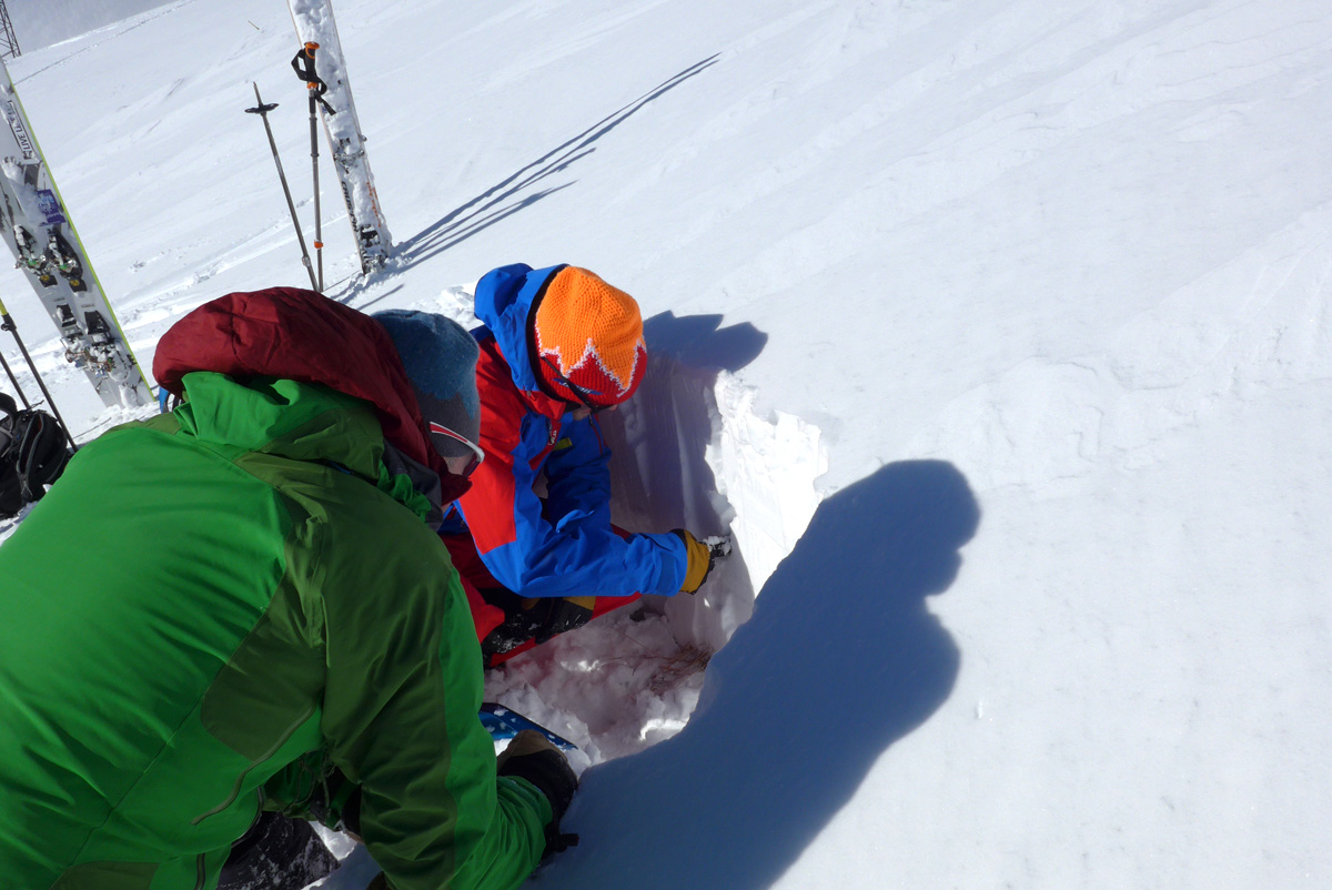 Max Cole (watching) and Dave Searle digging a snow profile in La Grave.