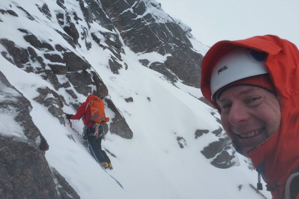 Graeme Ettle looks happy as I dick about in my own personal windy snowy hell. Photo by Calum Muskett.